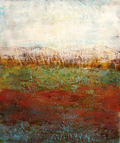 Copper leaf highlights this encaustic abstract landscape in reds, golds and greens