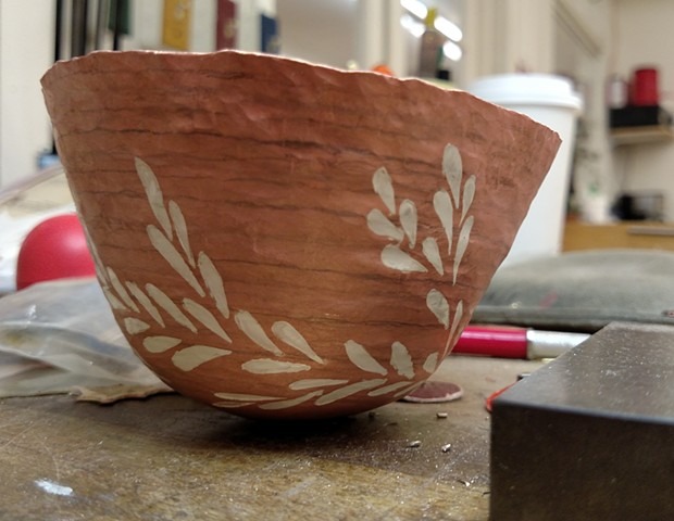 Marriage of metal cup in progress