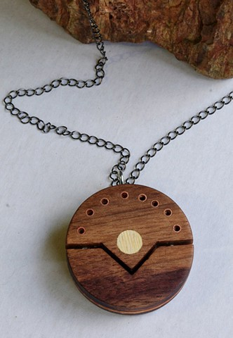 Round Wooden Pendant handcrafted with Recycled Wood and Copper tubing.