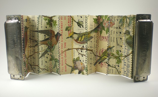 found object book, song birds, vintage harmonica
