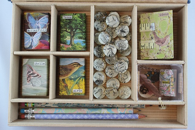 Artwork by Lesley Patterson-Marx, miniature books and more within a box made from an old book