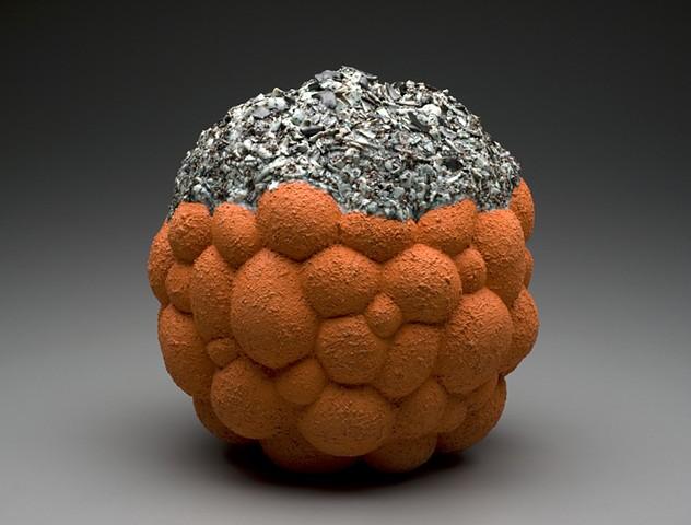 Ceramic sculpture: orange bubble cloud with crust fused with glaze