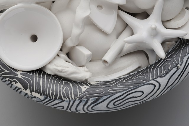 detail of black and white bowl with white contents