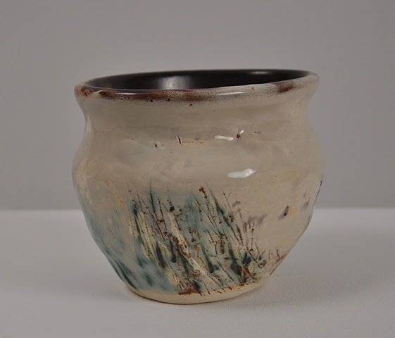almond and rust colored glazes on an oblong vase
