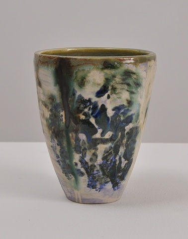ceramic cup with lavender, green, and blue glaze