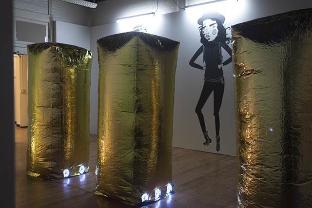 golden inflatable vitrines with Lauren's drawings of Rachael and my personae