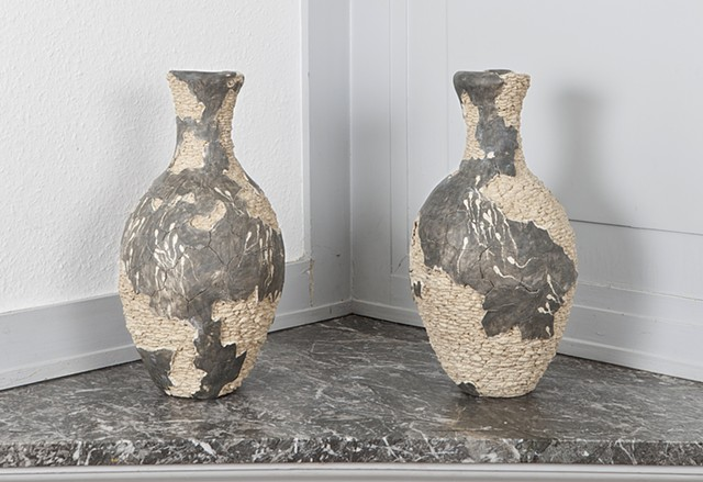 Clay vases with swimming sperm detail by artist Paul March entitled Possible Fertility Symbol