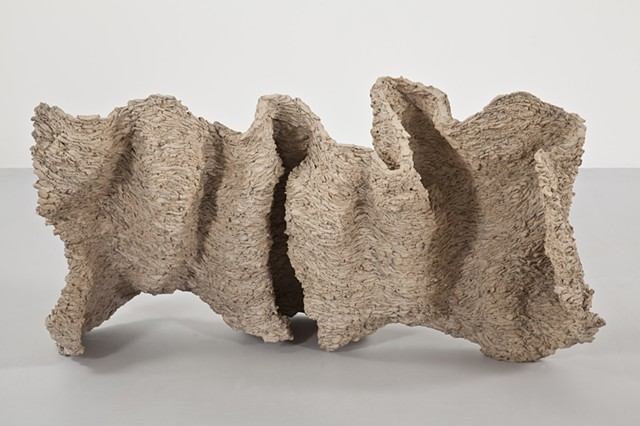 Clay sculpture by artist Paul March entitled Extended Phenotype 2, resembling organic wall