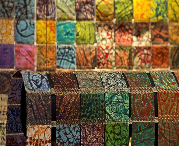 """Multiple Printing on handmade paper, cut in 2""""squares and sewn together into a paper quilt."""