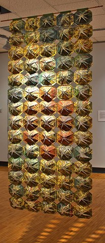 Multiple printing on paper, cut and sewn together into paper quilt hanging.