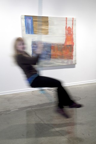 "Installation view: swinging in front of ""Floor Reflection..."""