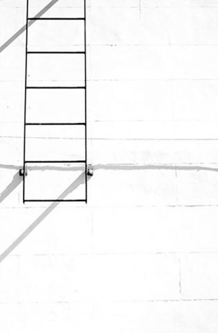 Fire escape ladder on white building. Savannah, GA