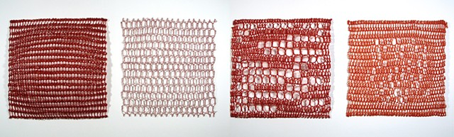 Crocheted fiberglass and polyester resin grid wall sculpture based on pi  by Yvette Kaiser Smith