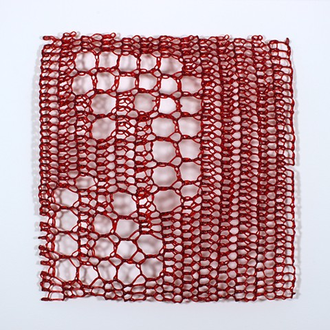 crocheted fiberglass red minimal geometric grid based on e sequence by Yvette Kaiser Smith