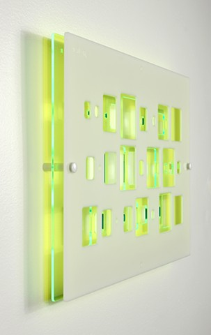 Green and white laser-cut acrylic template with geometric pattern based on pi by Yvette Kaiser Smith