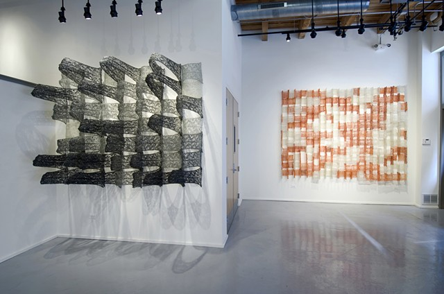 Geometric architectural grid crocheted fiberglass and polyester resin wall sculpture based on the numbers pi and e by Yvette Kaiser Smith