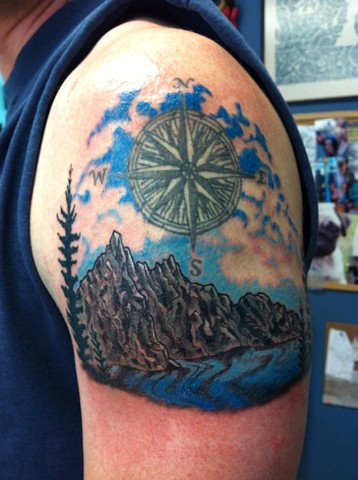 Derek's mountain scene added to a tattoo he already had (the compass was not by me)