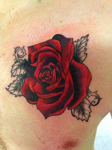 In-progress rose on chest