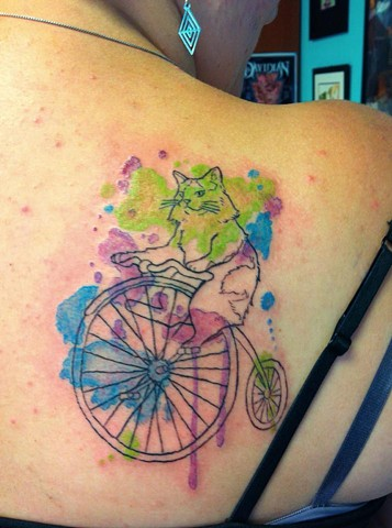 Water-color splatter cat-on-bicycle (her cat in real life doesn't have a tail, so neither does this one)