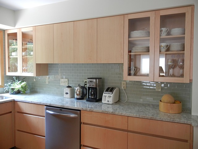 """Sleek, smooth, design with """"channel"""" for opening base cabinetry"""