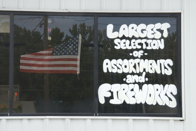 Flag in the window of a fireworks store
