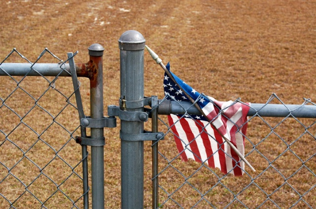 Flag In A Fence