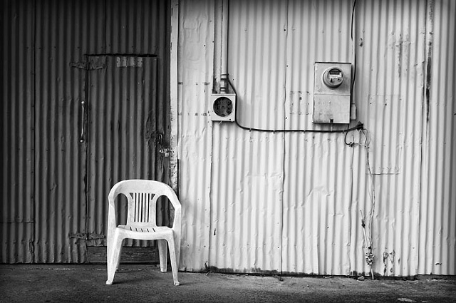 A Single Chair On A Loading Dock
