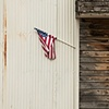 Flag On The Side Of An Old Warehouse