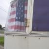 Flag In Camper Window