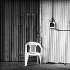 Single Chair On A Loading Dock