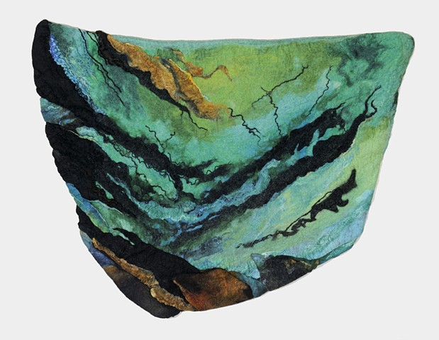 handmade felt wall piece made of dyed, unspun wool  by Sharron Parker. An abstract piece inspired by rocks, wind and water.