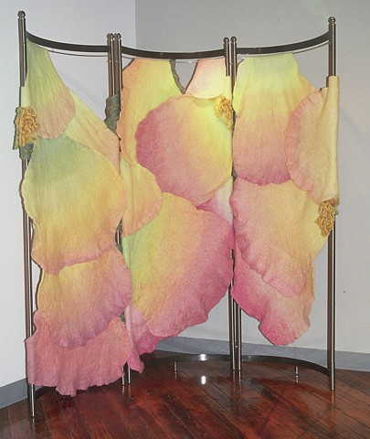 A handmade felt screen which works in a corner or as a room divider. It was made of dyed, unspun wool and yarns by Sharron Parker, It was based on Peace Rose petals.