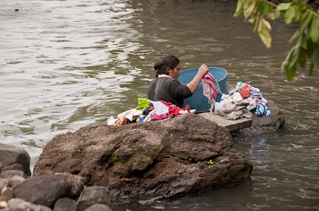 Washing clothes in the river.