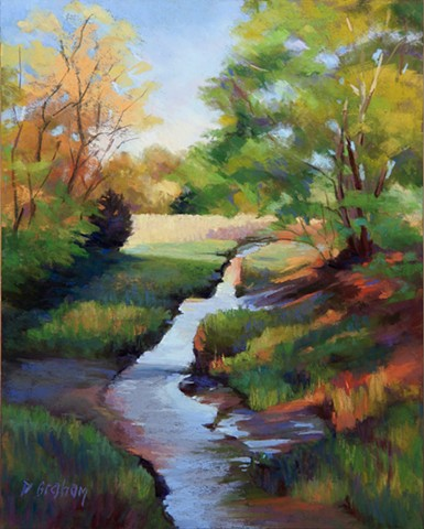 A stream running to river in September