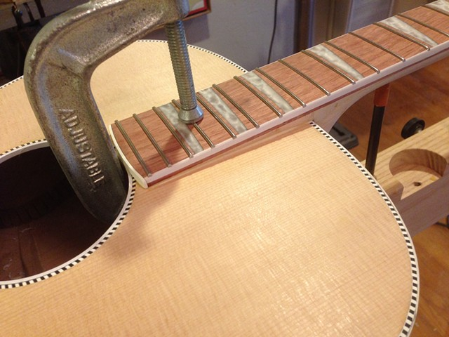 Clamping tapered fretboard extension to glue to top