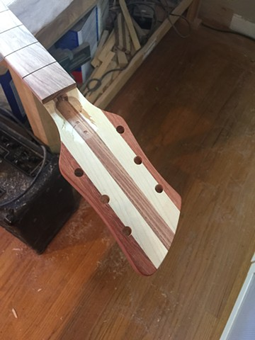 HEADSTOCK WITH WENGE CENTER STRIP, PADAUK WINGS