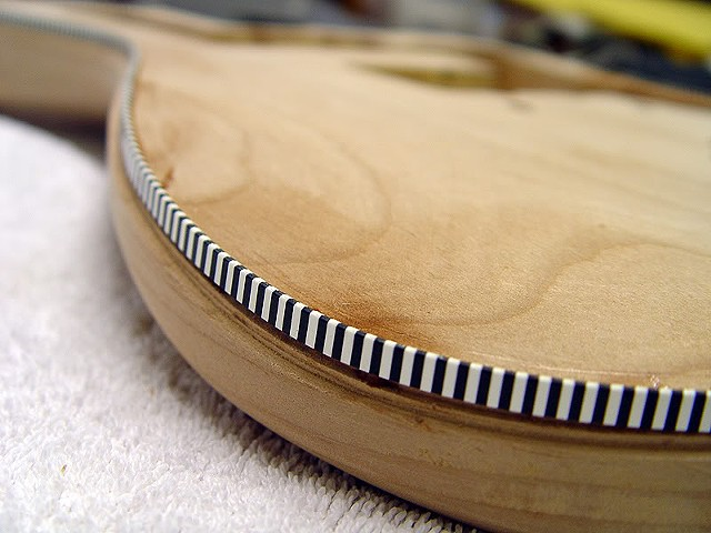 Fender Custom Jazzmaster with Binding and Transparent Cherry Shaded Finish--Closeup of Purfling in Arm Cut Area of Top