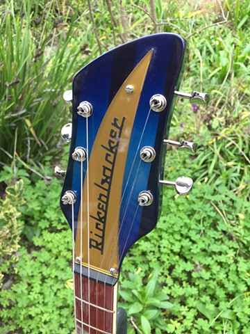 HEADSTOCK DETAIL WITH GOLD NAMEPLATE