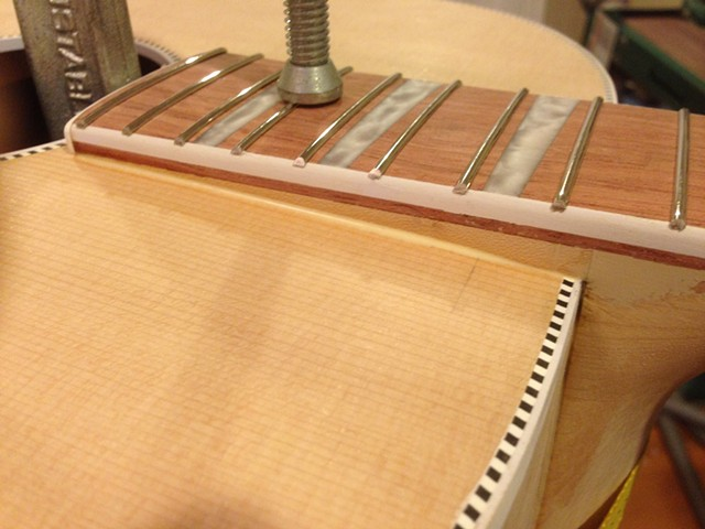 Close-up of extension being clamped and glued to top