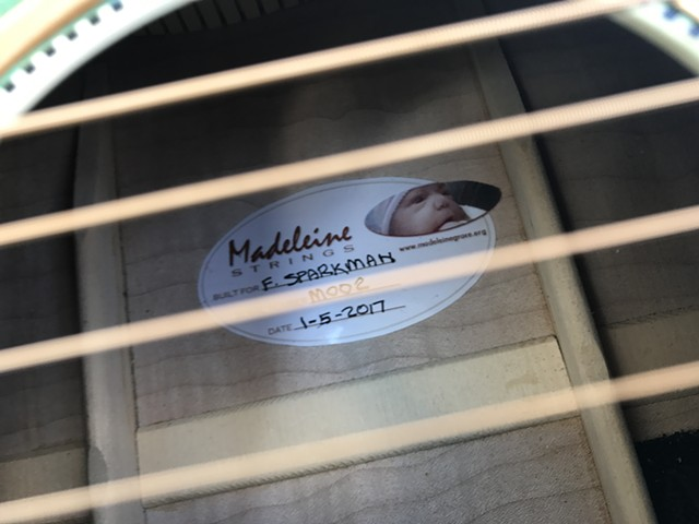Label Viewed Through Sound Hole