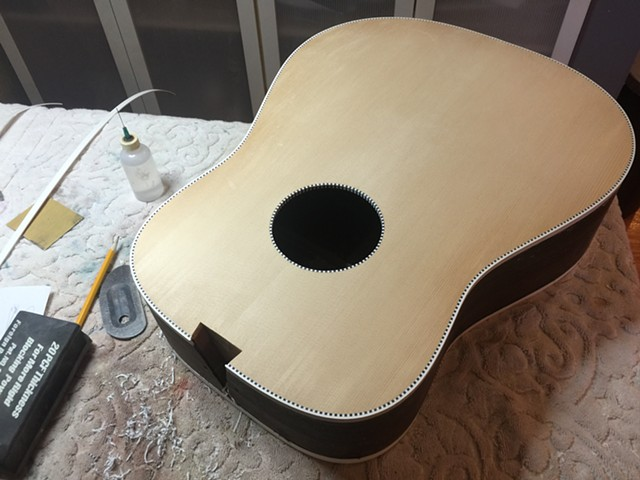 BINDING ON TOP, BACK, SOUND HOLE SCRAPED FLUSH