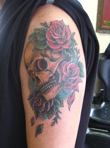 skull and roses tattoo by artist Sadie Kennedy, Sweet Trade Tattoo, Lahaina, Maui.  Best tattoo shop in Maui!