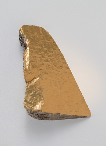 sculpture with gold tape and found foam material