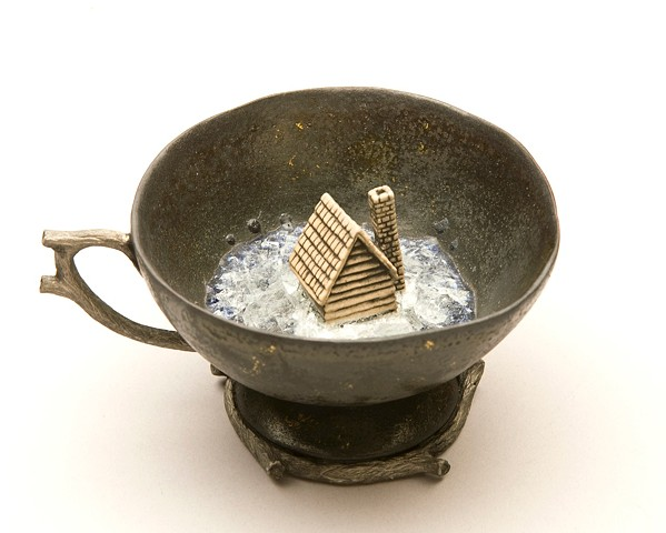 porcelain teacup with house and glass
