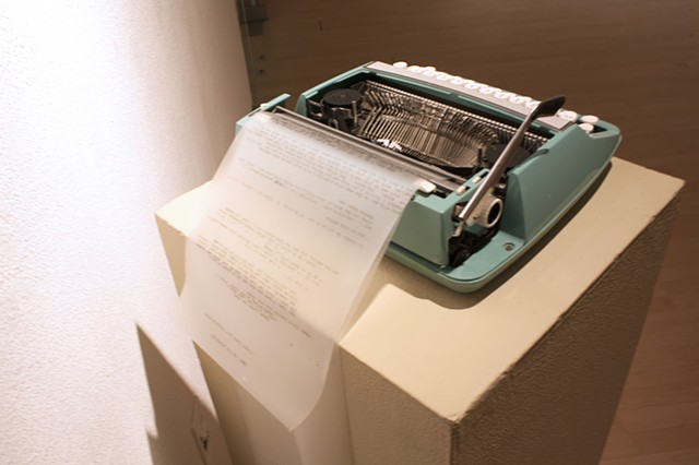 Typewriter with paper for viewer commentary.