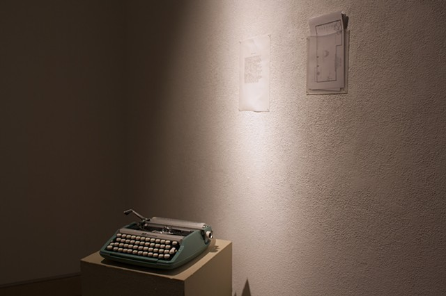 Typewriter with paper for viewer comments (front) Artist Statement (back left) Gallery Maps (back right)