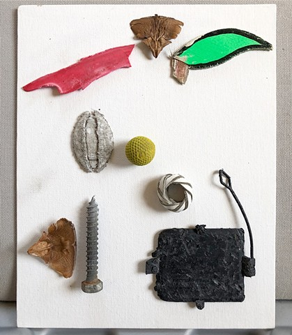 This found object assemblage showing an abstract bird was made using objects found on that day, and glued to a canvas board