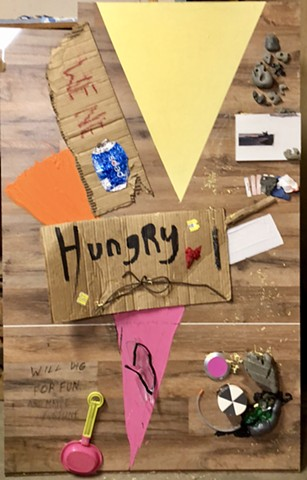 This found object art piece by Steven Tannenbaum used a found homeless sign along with other objects to create a semi abstract view of the world