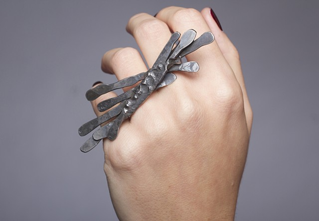 a one-of-a-kind ring composed of forged steel wire and sterling silver