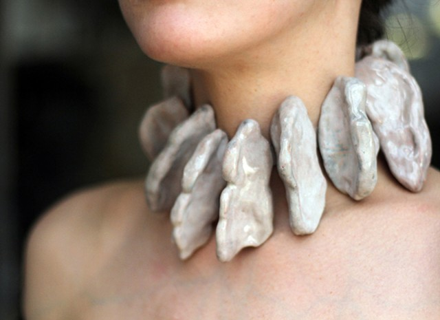 a one-of-a-kind sculptural neckpiece composed of copper forms that are coated in flesh tone enamel